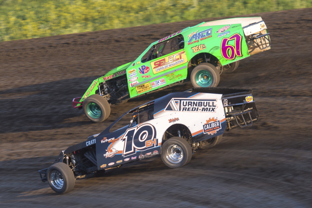A battle for the ages. Stormin Joren Boyce (67), Ed Turnbull (10eh) 2014 IMCA Modifieds