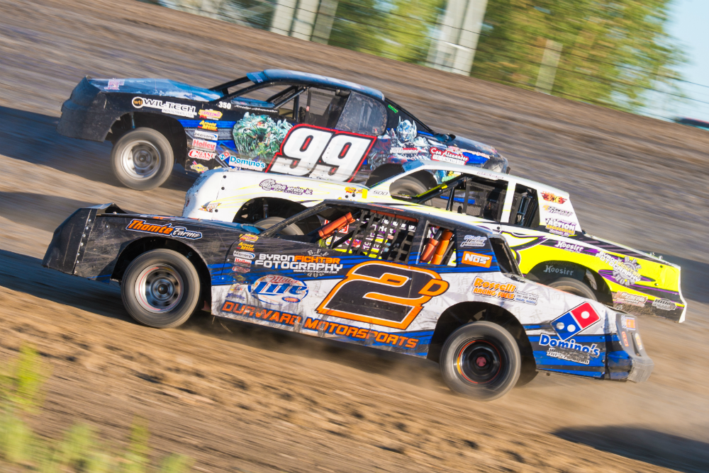 Rocky Alexander (99), Gregg Mann (95), and Jordan Durward (2d) 3 wide in corners 1 and 2. 2014