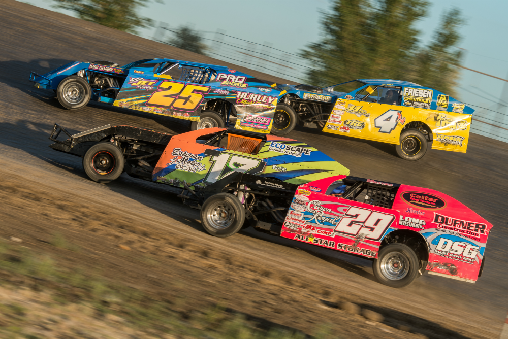 Tim Ward (4tw), Hank Berry (25), Ryan Harris (18), and Drew Christiansen (29) go four wide in heat action during the 2014 Dakota Classic Modified Tour Heat Races